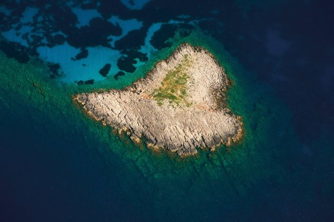 Heatr-shaped island in Greece